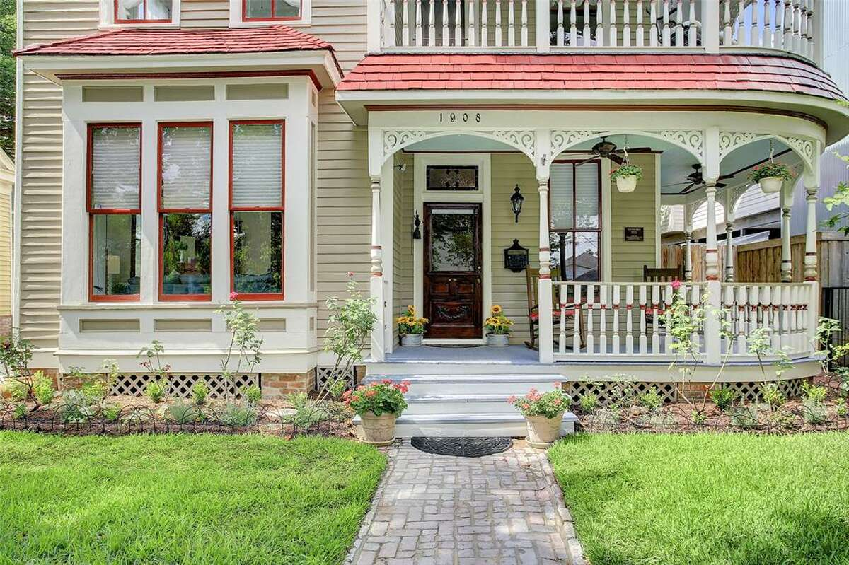 The home has two wrap-around porches with both including delicate spindlework, ceiling fans, and coach lanterns.