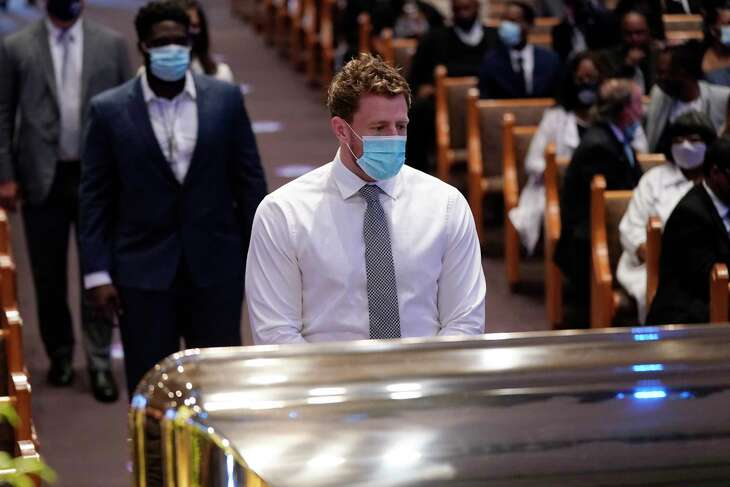 Houston Texans NFL player J. J. Watt, pauses by the casket of George Floyd during a funeral service for Floyd at The Fountain of Praise church Tuesday, June 9, 2020, in Houston.