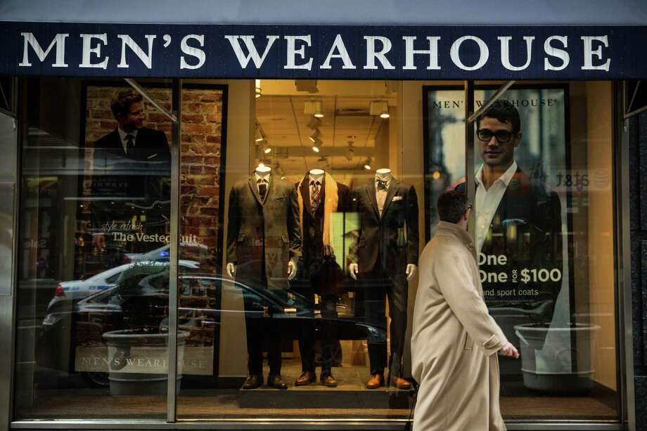 A man walks past a Men's Warehouse store in New York City. Photo: Andrew Burton, Staff / Getty Images / 2014 Getty Images