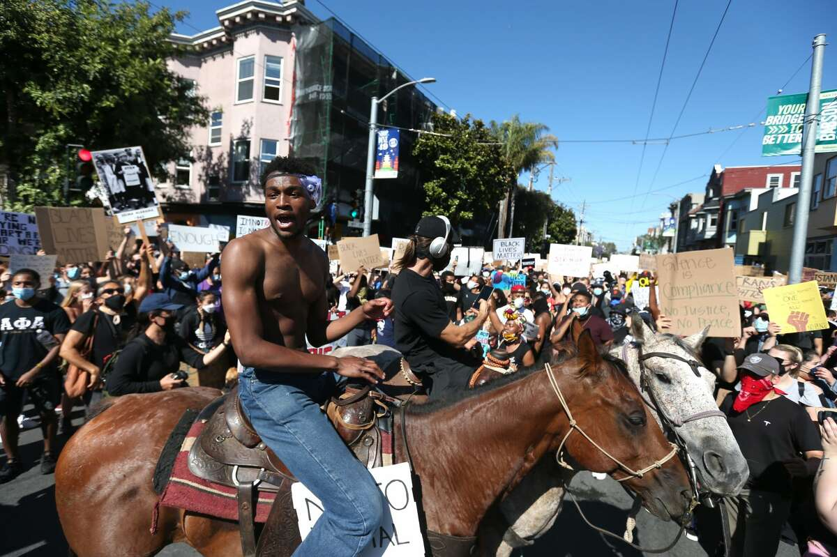 Protesters sit on horses during a demonstration to honor of George Floyd on June 03, 2020 in San Francisco, California. Thousands of of people came out to honor George Floyd who died after being held down by Derek Chauvin, a former member of the Minneapolis Police Department who has since been fired and charged with third degree murder.