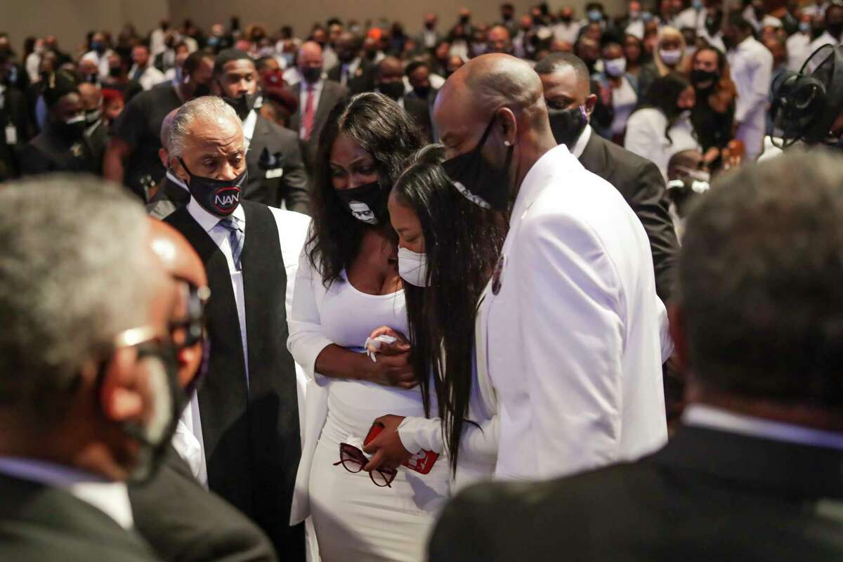 Family members react as they view the casket during the funeral for George Floyd on Tuesday, June 9, 2020, at The Fountain of Praise church in Houston. Floyd died after being restrained by Minneapolis Police officers on May 25.