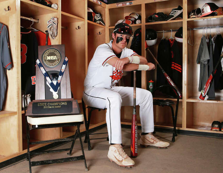 Edwardsville's Drake Westcott poses in the Tigers locker room at Tom Pile Field with the 2019 Class 4A state championship trophy after he won Telegraph Player of the Year honors as a junior. Now a senior, Westcott will either have his name called in this week's MLB draft or head to college baseball at Louisville. Photo: Billy Hurst | For The Telegraph