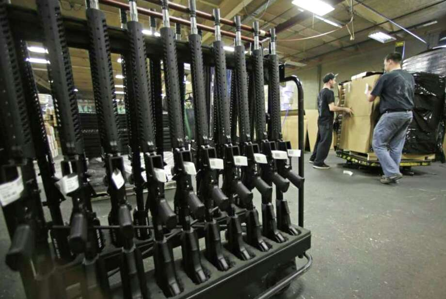 FILE - In this April 10, 2013 file photo, newly made AR-15 rifles stand in a rack at Stag Arms in New Britain, Conn. (AP Photo/Charles Krupa, File) Photo: Photo /Charles Krupa, Associated Press