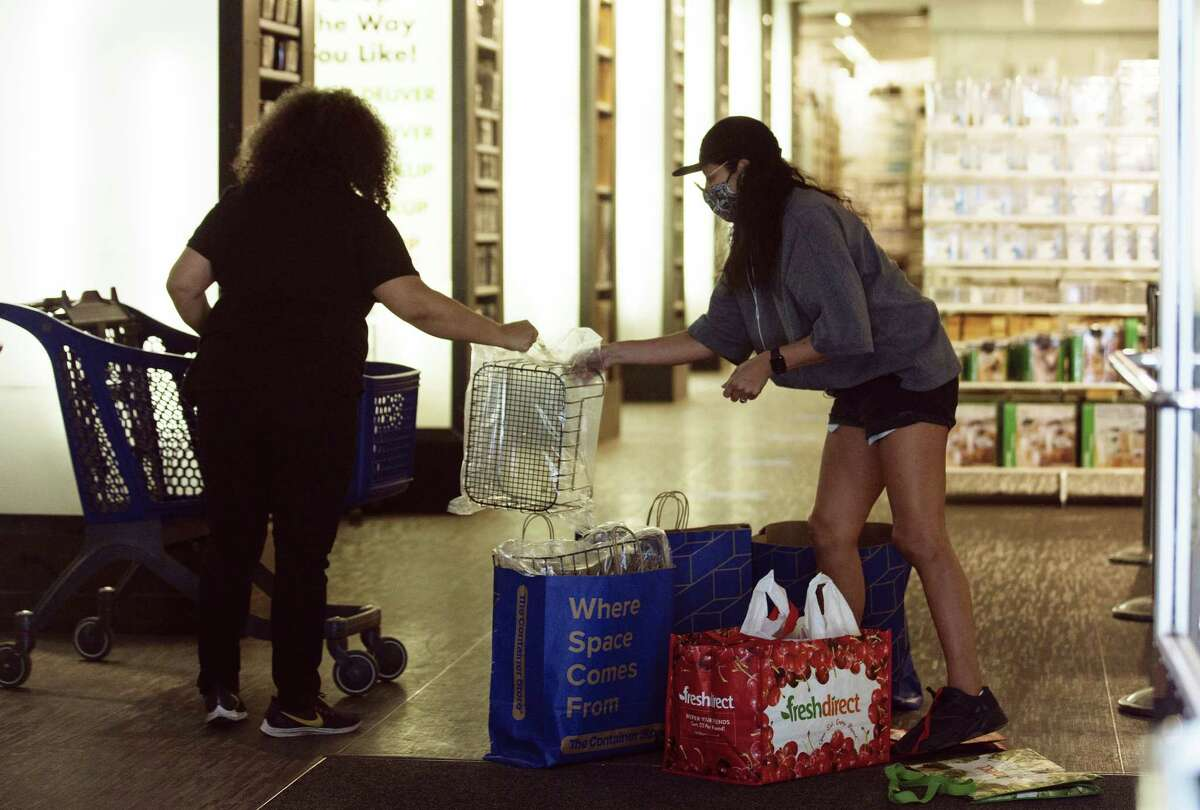 """An employee assists a customer with purchases at a Container Store Inc. location open for curbside pickup in New York, U.S., on Monday, June 8, 2020. Only 1.2% of New Yorkers tested Sunday were infected with the new coronavirus, the lowest rate since the pandemic began. """"Why are wereopening? Because these numbers say we can,"""" GovernorAndrew Cuomosaid said at a news conference in Manhattan. Photographer: Angus Mordant/Bloomberg"""