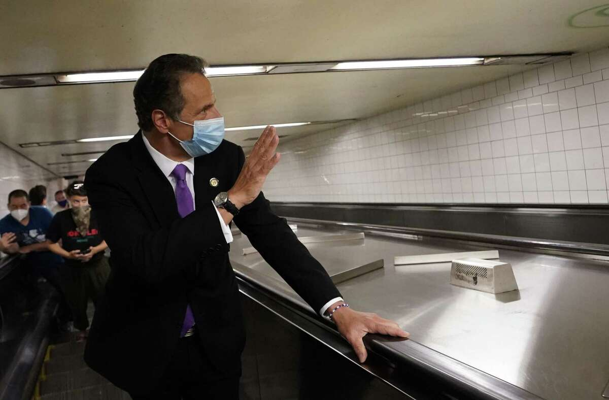 New York Governor Andrew Cuomo takes the escalator after riding the New York City subway 7 train into the city on June 8, 2020 in New York. - Today New York City enters