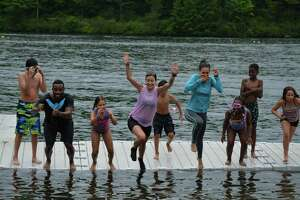 Children from Camp Hope from a prior summer. Sasha Collins, Camp HOPE coordinator & youth trauma specialist, is in blue