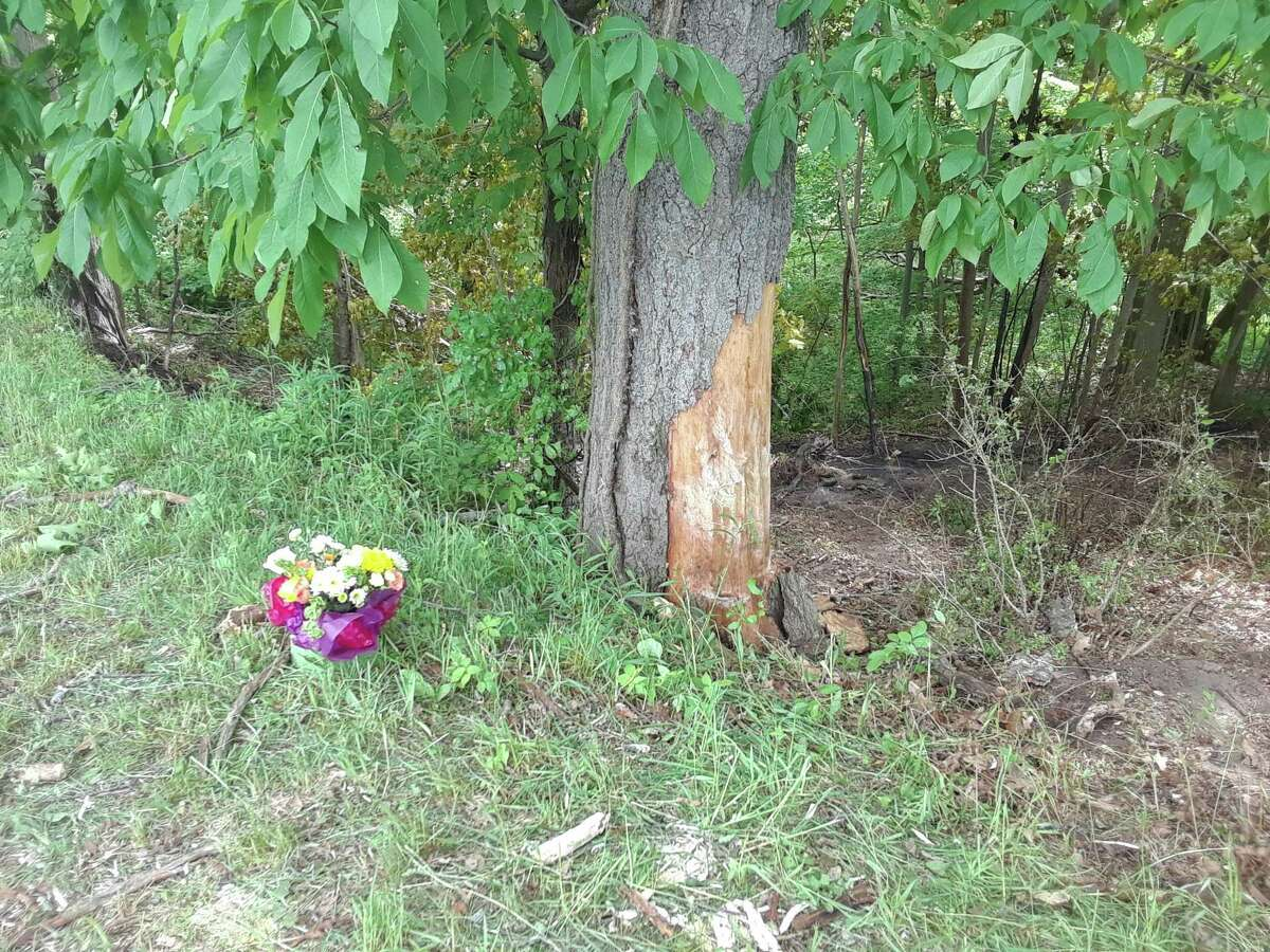 A bouquet of flowers was left at the crash site of the June 9 accident that claimed the lives of two Litchfield High School students.
