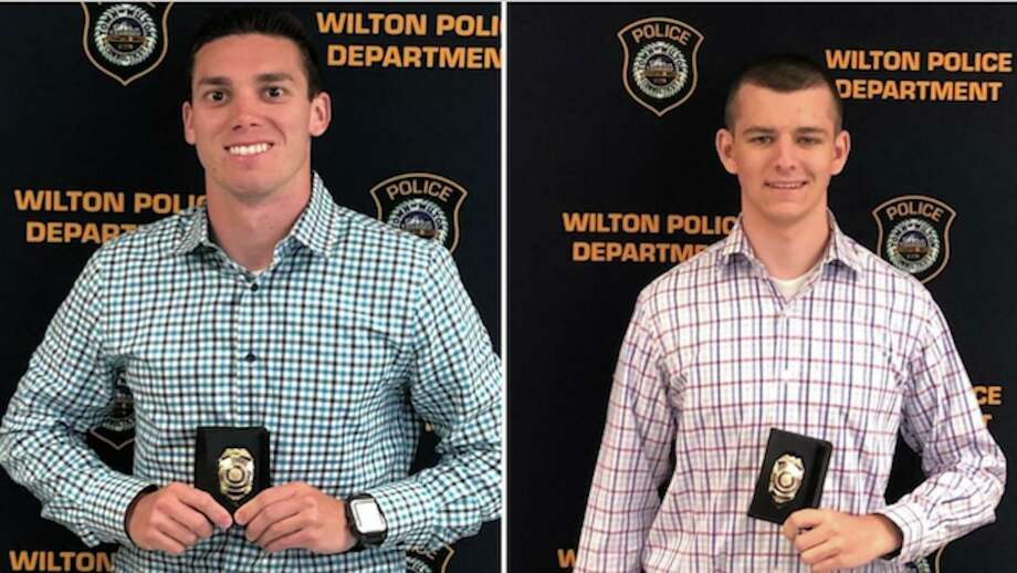 Steven Anuszkiewicz of New Canaan, left, and Matthew Cisewski of New Fairfield, right, were newly sworn in as Wilton police officers on June 9. They will be attending the Connecticut Police Academy in Meriden starting June 12. Photo: Wilton Police Department Photos