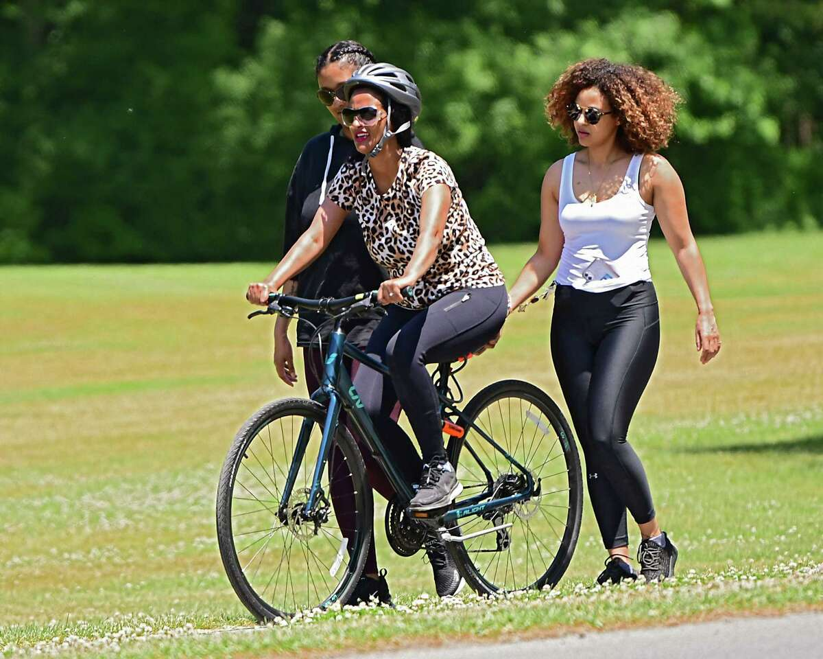 Liya Sisay of Brooklyn, right, helps her friend Tita Gashaw of New Jersey learn how to ride a bike in Saratoga Spa State Park on Tuesday, June 9, 2020 in Saratoga Springs, N.Y. The women, including one who wished not to be named, came upstate to get away and relax. (Lori Van Buren/Times Union)