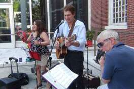 """Barbara Occhino, singer and band manager of Barbara's Serenade, plays jazz and Latin music on Make Music Day in 2018, accompanied by Daniel Swartz on guitar and Al Brooks on saxophone and flute. The trio will perform as part of this year's """"Make Music Stamford Downtown"""" June 21, on the corner by Ferguson Public Library from 1 to 2:30 p.m., and at Latham Park from 3:30 to 4:30 p.m."""