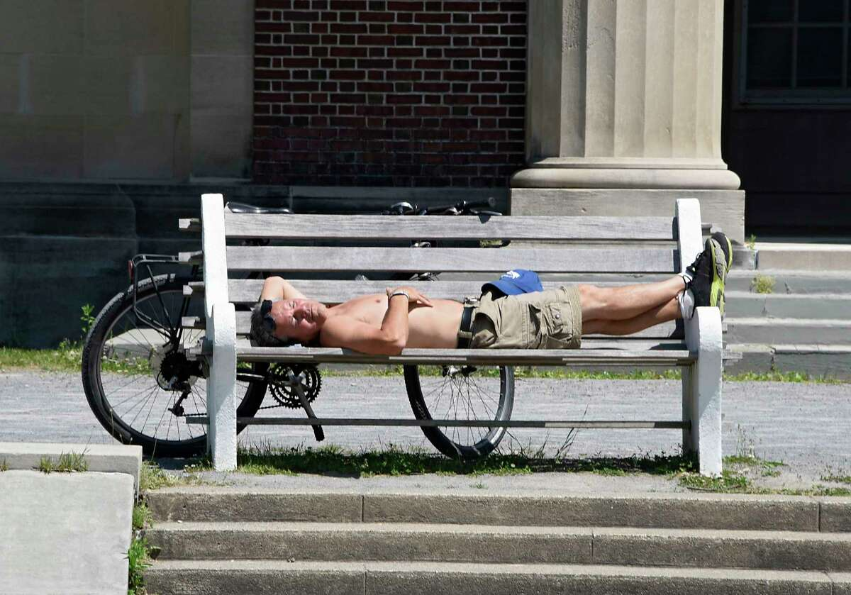 Pat Correa of Saratoga Springs takes a break from riding his bike to work on his tan in Saratoga Spa State Park on Tuesday, June 9, 2020 in Saratoga Springs, N.Y. (Lori Van Buren/Times Union)