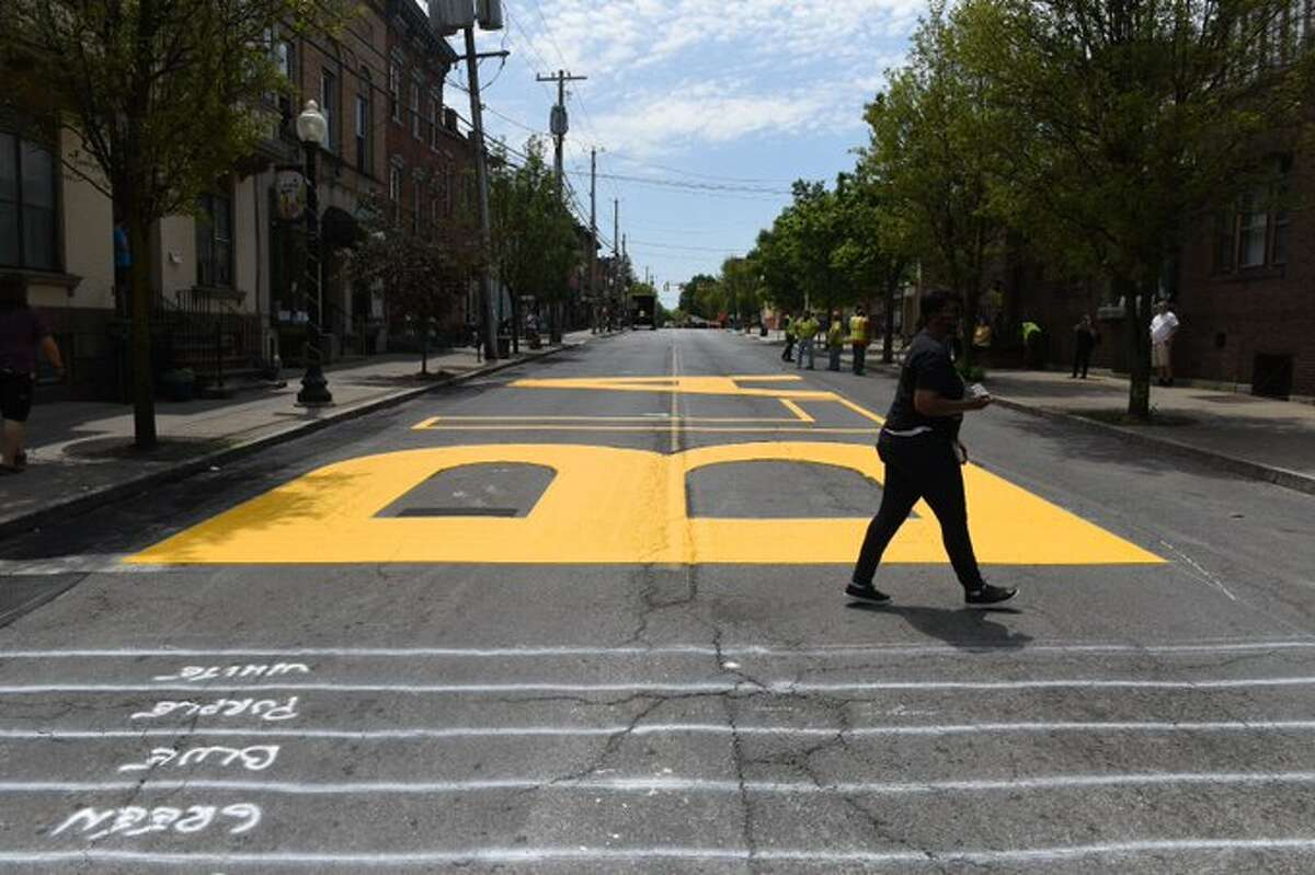 The message Black Lives Matter is painted on Lark Street. Schenectady Mayor Gary McCarthy said the city is considering creation of a similar sign on the street outside City Hall or in front of Proctors theater.
