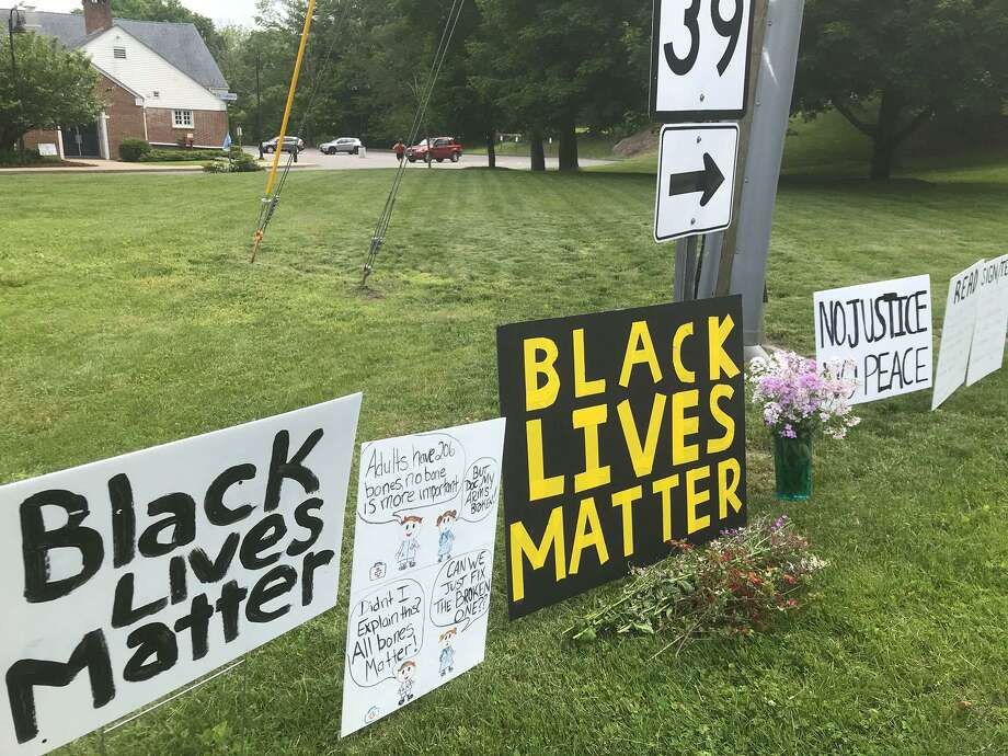 Signs supporting the Black Lives Matter movement in Sherman, Conn., before town officials announced ad-hoc signs at the intersection would be removed. Photo: Contributed Photo / Emily Cozart Mohammed