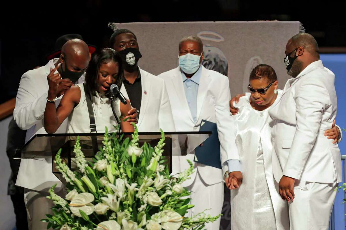 Brooke Williams, niece of George Floyd, speaks with the rest of the family, during the funeral for George Floyd on Tuesday, June 9, 2020, at The Fountain of Praise church in Houston. Floyd died after being restrained by Minneapolis Police officers on May 25.