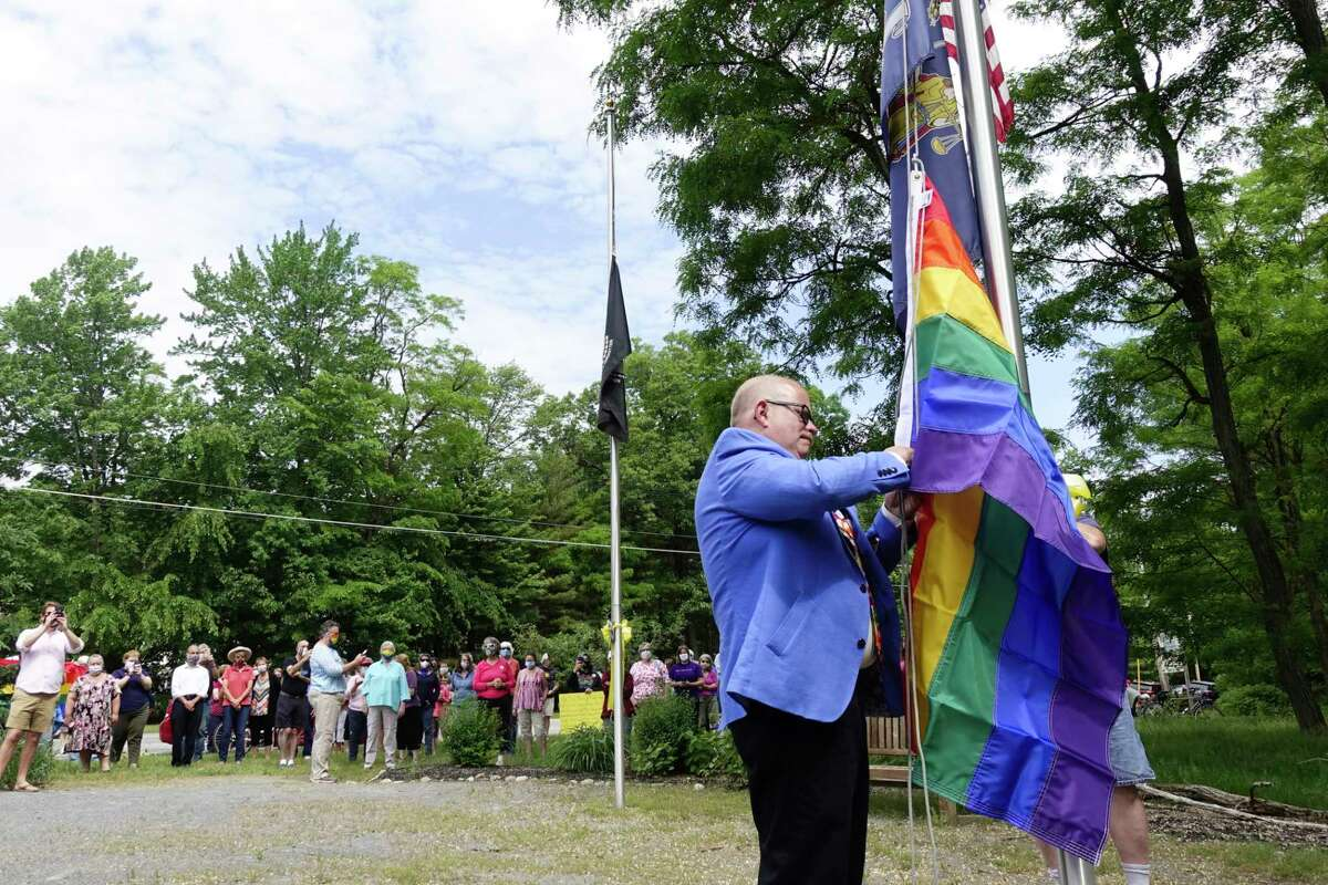 Milton Town Supervisor Benny Zlotnick puts up a pride flag during an event at a memorial park on Tuesday, June 9, 2020, in Milton, N.Y. Two previous pride flags have been stolen after they were put up at the park and Zlotnick was there to put another pride flag up. (Paul Buckowski/Times Union)