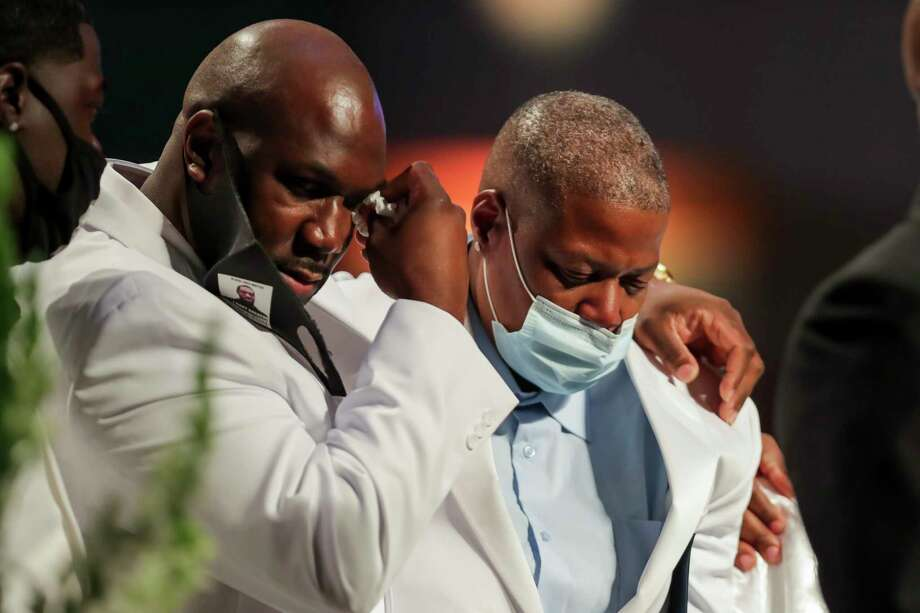 Philonise Floyd puts his arm around his sister LaTonya Floyd as the family speaks during the funeral for George Floyd on Tuesday, June 9, 2020, at The Fountain of Praise church in Houston. Floyd died after being restrained by Minneapolis Police officers on May 25. Photo: Godofredo A. Vásquez, Houston Chronicle / Copyright 2020 Godofredo A. Vásquez/HOUSTON CHRONICLE. All rights reserved.