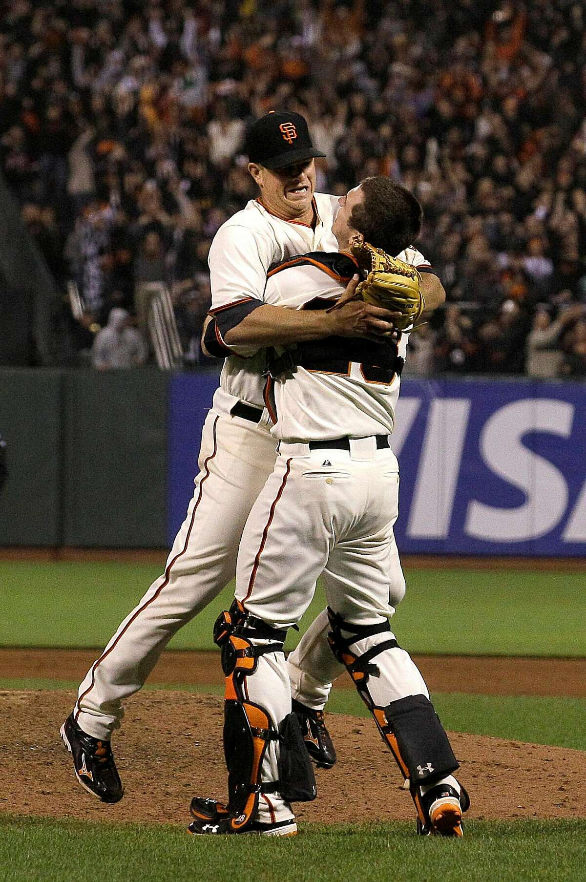 San Francisco Giants pitcher Matt Cain, left, celebrates with catcher Buster Posey after the final out of the ninth inning of a baseball game against the Houston Astros in San Francisco, Wednesday, June 13, 2012. Cain pitched the 22nd perfect game in major league history and first for the Giants, striking out a career-high 14 and getting help from two spectacular catches to beat the Houston Astros 10-0. (AP Photo/Jeff Chiu)
