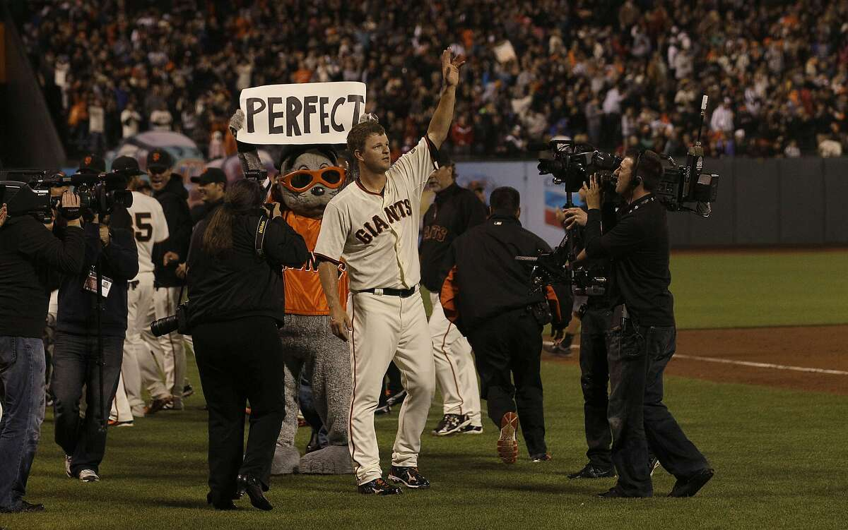 San Francisco Giants pitcher Matt Cain celebrates after the final out of the ninth inning of a baseball game against the Houston Astros in San Francisco, Wednesday, June 13, 2012. Cain pitched a perfect game. The Giants won 10-0. (AP Photo/Jeff Chiu)