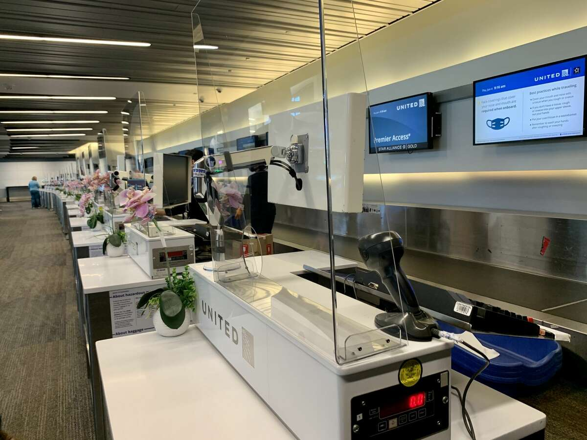 If you need to interact with an agent at the airport, you'll most likely be speaking from behind plastic barriers. United Airlines has installed see-through guards at agent desks (seen in this photo) made by technicians at the carrier's San Francisco maintenance base.