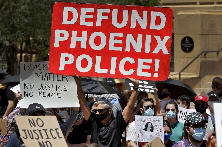 Protesters rally Wednesday, June 3, 2020, in Phoenix, demanding that the Phoenix City Council defund the Phoenix Police Department. The protest is a result of the death of George Floyd, a black man who died after being restrained by Minneapolis police officers on May 25. Photo: Matt York, Associated Press
