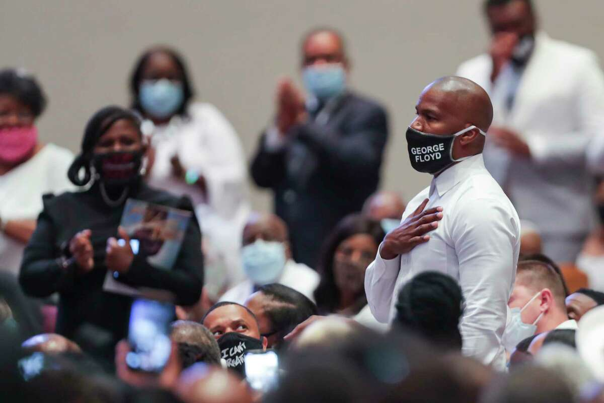 Actor Jamie Foxx is recognized by the Rev. Al Sharpton during the funeral for George Floyd on Tuesday, June 9, 2020, at The Fountain of Praise church in Houston. Floyd died after being restrained by Minneapolis Police officers on May 25.