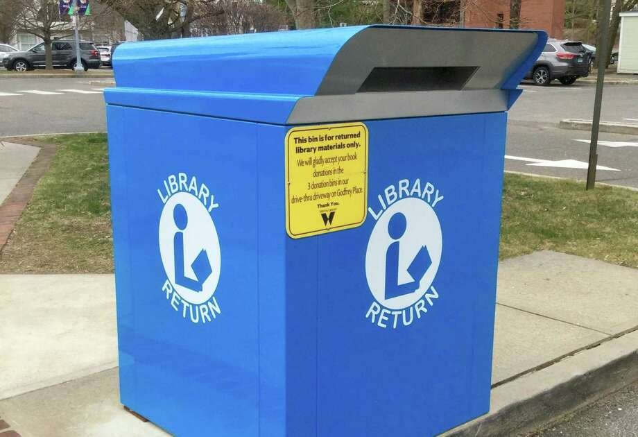 The blue bins at Wilton Library will reopen for return of materials on June 16. A drive-thru window will be open to pick up physical materials beginning Monday, June 22, at 10 a.m. Photo: Contributed Photo / Wilton Library / Wilton Bulletin Contributed