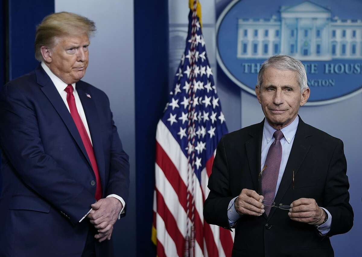 Dr. Anthony Fauci (R), director of the National Institute of Allergy and Infectious Diseases, and U.S. President Donald Trump participate in the daily coronavirus task force briefing at the White House on April 22, 2020 in Washington, DC. Dr. Robert Redfield, director of the Centers for Disease Control, has said that a potential second wave of coronavirus later this year could flare up again and coincide with flu season. (Drew Angerer/Getty Images North America/TNS)