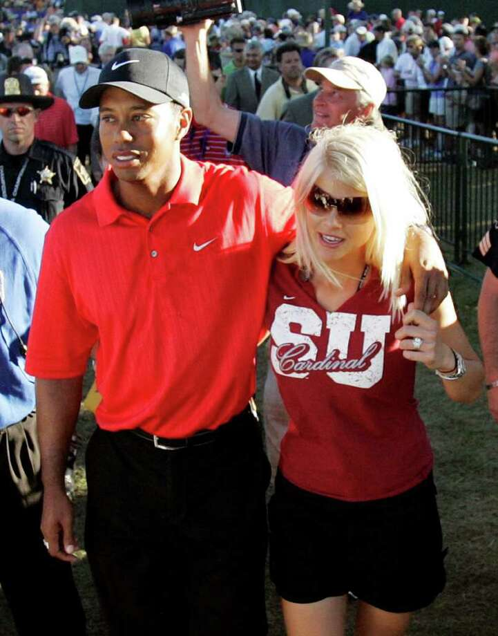 In this Aug. 20, 2006, file photo, Tiger Woods celebrates with wife Elin Nordegren after winning the 88th PGA Championship golf tournament at Medinah Country Club in Medinah, Ill. (Rob Carr / Associated Press) Photo: ROB CARR
