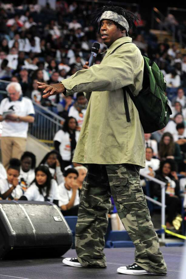 """Dr. Adolph Brown, a self-described """"Edu-tainer"""", gives the key note address during the Bridgeport Youth Summit held at the Webster Bank Arena in Bridgeport, Conn. April 1, 2016. Photo: Ned Gerard / Hearst Connecticut Media / Connecticut Post"""