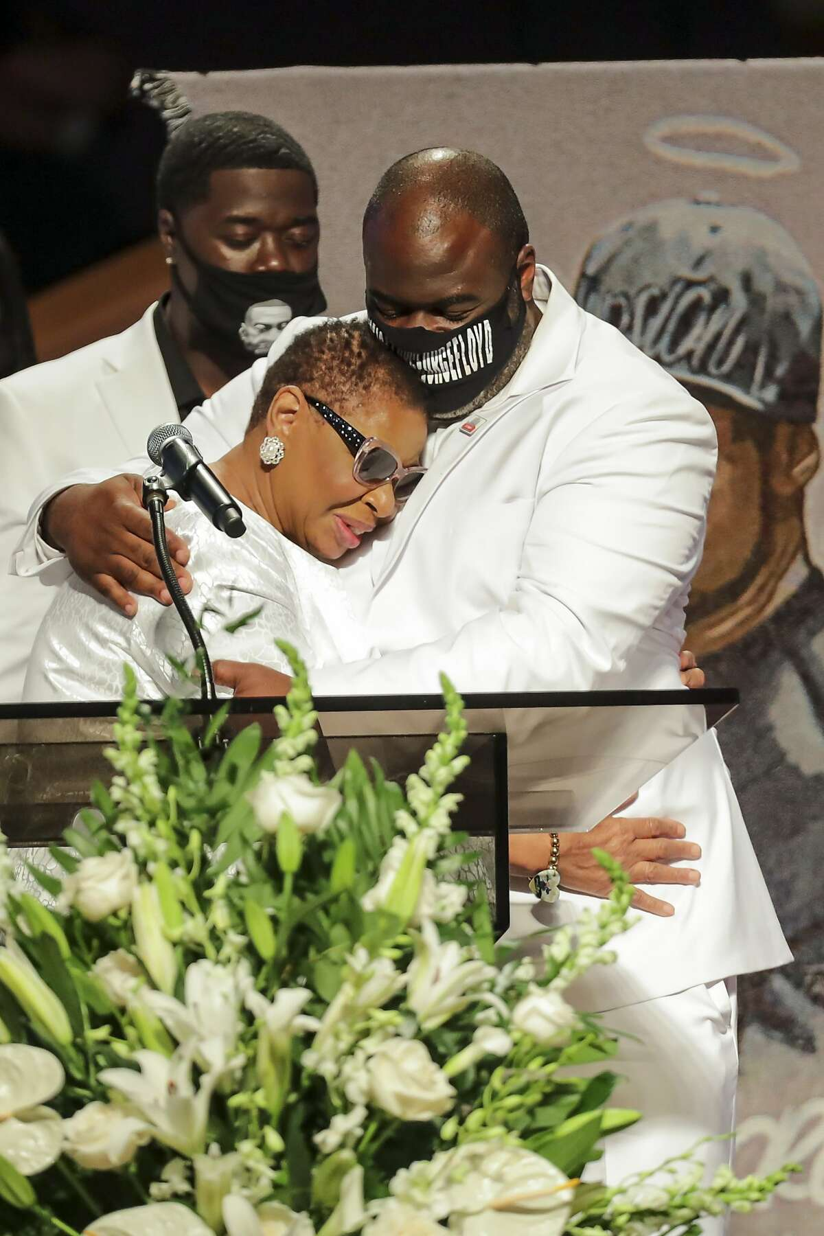 Rodney Floyd hugs his aunt as the family speaks during the funeral for Floyd's brother, George Floyd, on Tuesday, June 9, 2020, at The Fountain of Praise church in Houston. Floyd died after being restrained by Minneapolis Police officers on May 25.
