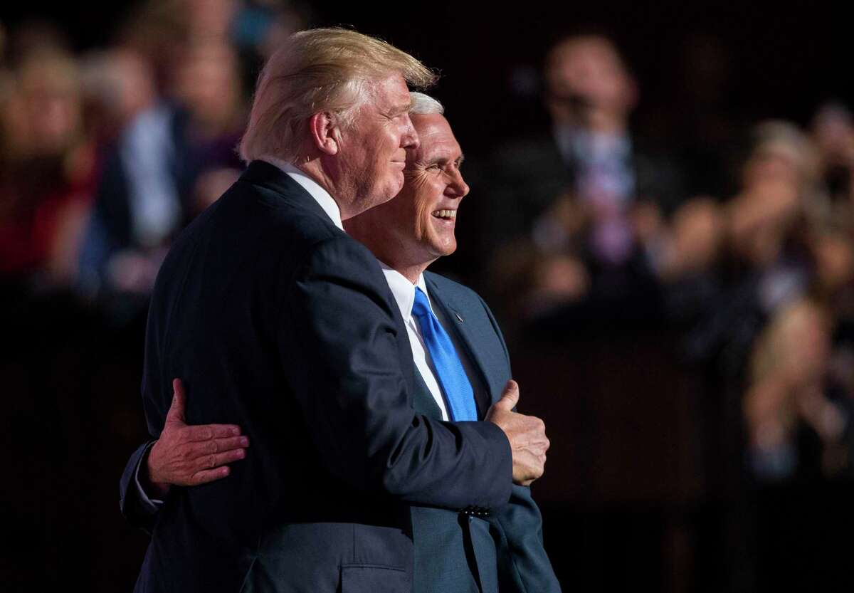 FILE -- Donald Trump joins Mike Pence on stage after the Indiana governor accepted the party's vice-presidential nomination, at the Republican National Convention in Cleveland, July 20, 2016. Traditionally prospective vice presidents were asked whether they would like to be so-and-so's running mate, they would typically follow some variation on the familiar dodge but that custom is fading in this strange lockdown of a veepstakes season. (Doug Mills/The New York Times)