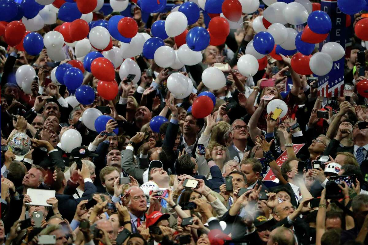 FILE - In this July 21, 2016, file photo, confetti and balloons fall during celebrations after Republican presidential candidate Donald Trump's acceptance speech on the final day of the Republican National Convention in Cleveland. President Donald Trump demanded Monday, May 25, 2020, that North Carolina's Democratic governor sign off