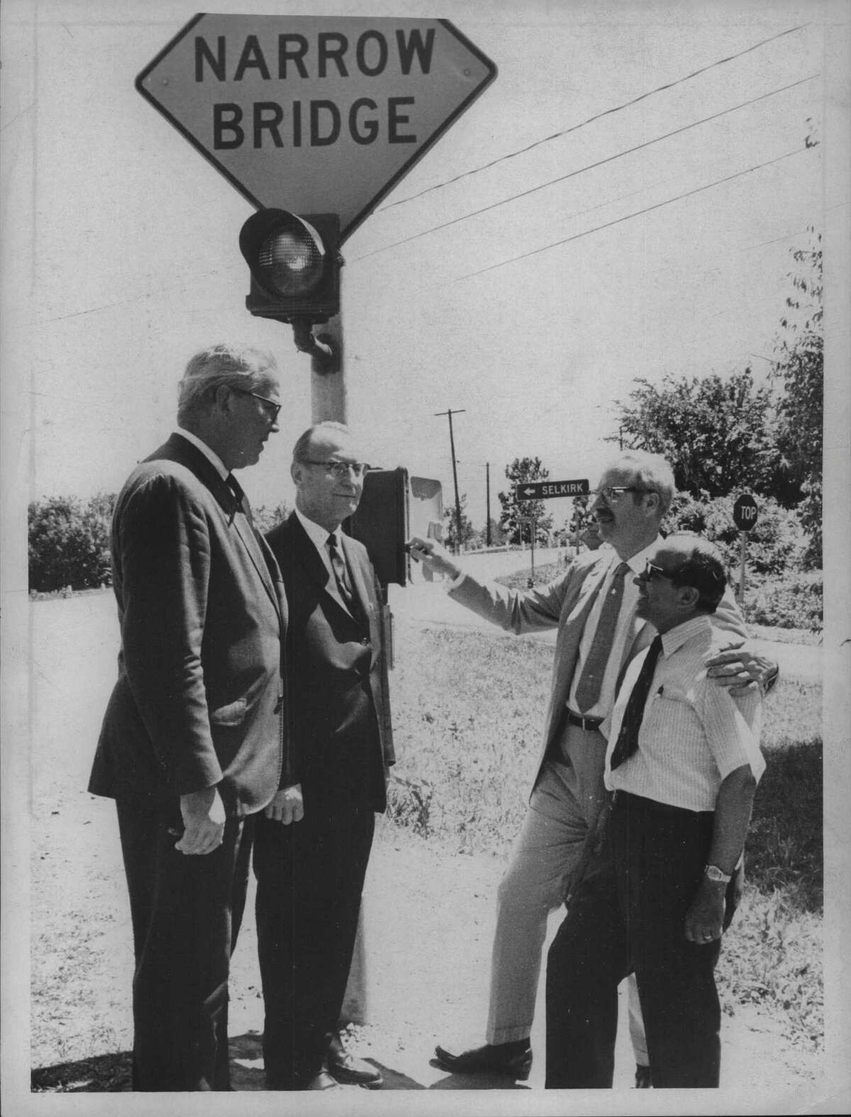 An undated photo shows Sen. Walter Langley, town Supervisor Bert Kohinke, Assemblyman Ray Skose, and Ravena-Coeymans-Selkirk Superintendent Frank Fillipone at the Dibbs Bridge in Selkirk. A school bus crash 50 years ago near the site sent 15 RCS schoolchildren to the hospital. (Jack Pinto/Times Union Archive)