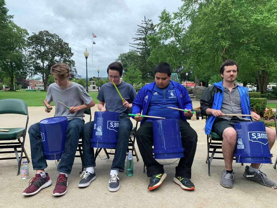 Northwest Connecticut Arts Council's annual Make Music Day returns June 21, featuring musicians performing in and around Torrington. Above, a group play bucket drums. Photo: Contributed Photo /