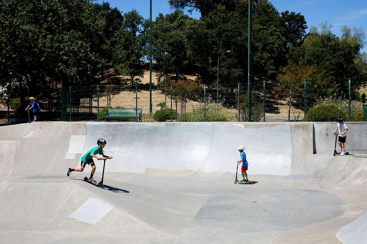 Kids play at the skate park at Heather Farm Park in Walnut Creek, Calif. Tuesday, June 9, 2020. They Bay Area is opening at a fairly fast pace, with Contra Costa County announcing plans this week to reopen indoor dining and hair salons soon, while it reports near-record new cases.