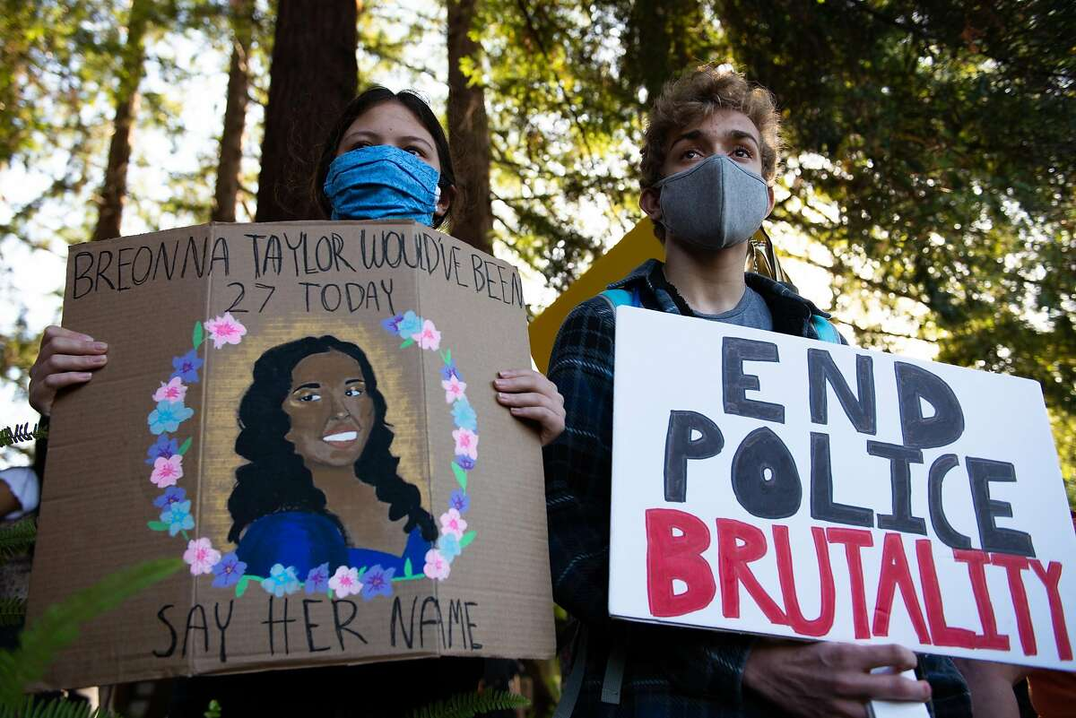 Sydney Scott, 14 years old, and friend Mateo Flores, 16 years old, hold a signs during a peaceful protest in solidarity with the Black community outside of City Hall on June 5, 2020 in Sunnyvale, Calif.