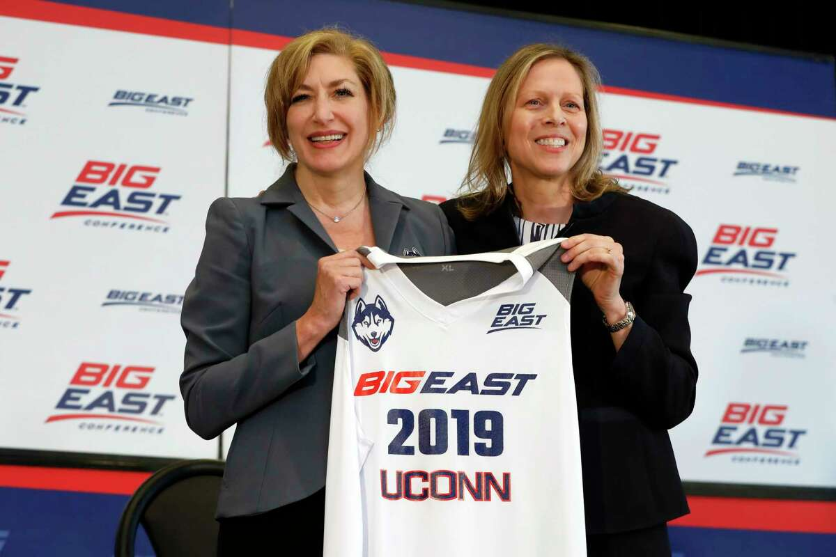 Fromer UConn president Susan Herbst, left, and Big East Commissioner Val Ackerman, pose for photos at the announcement that the Huskies were re-joining the conference last year in New York. According to a source, the Big East women's basketball coaches are in favor of keeping 20-game conference schedule.