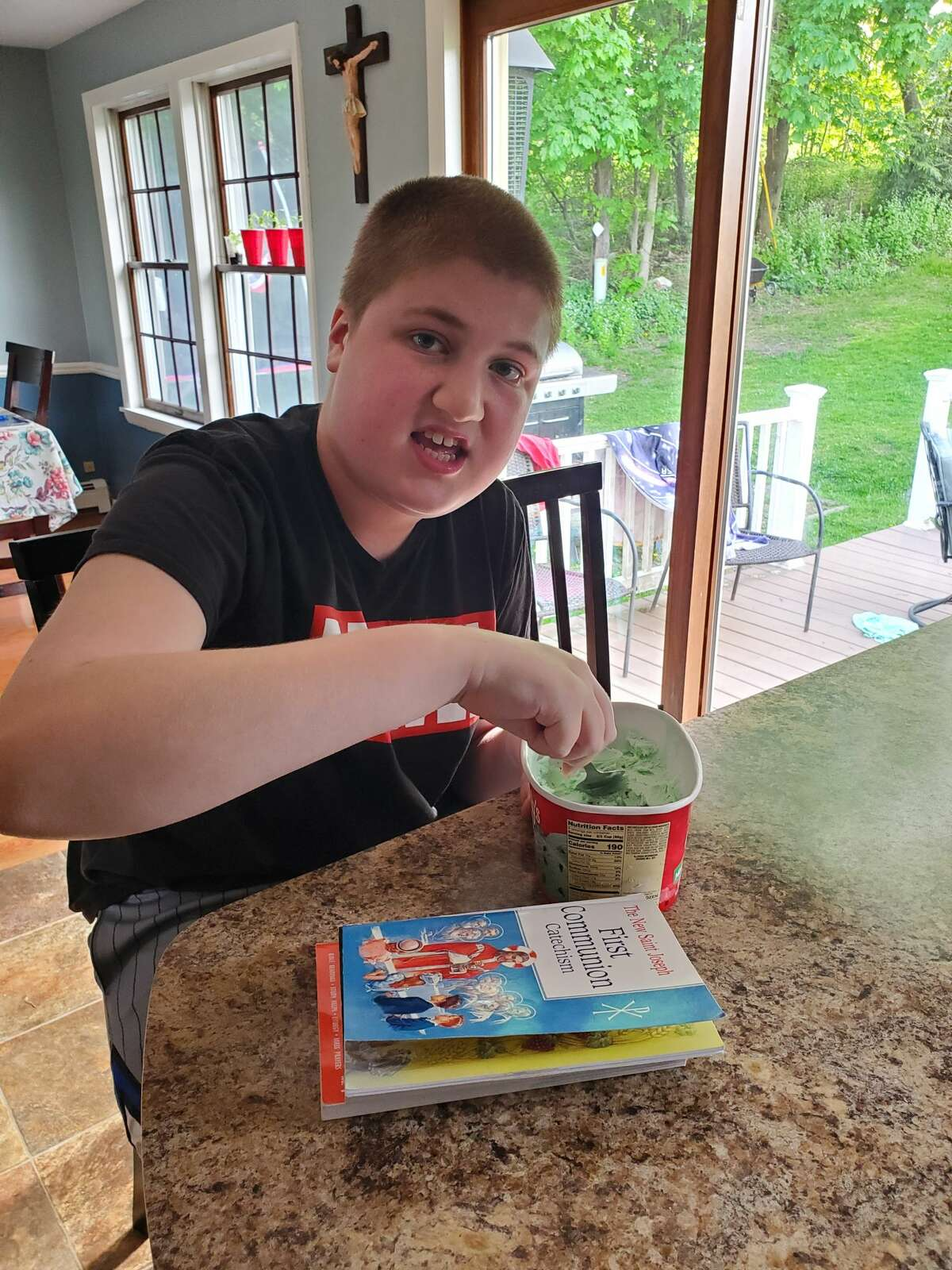Kristopher Hoffman, 15, has struggled since having to stay home from the Wildwood School during the pandemic.