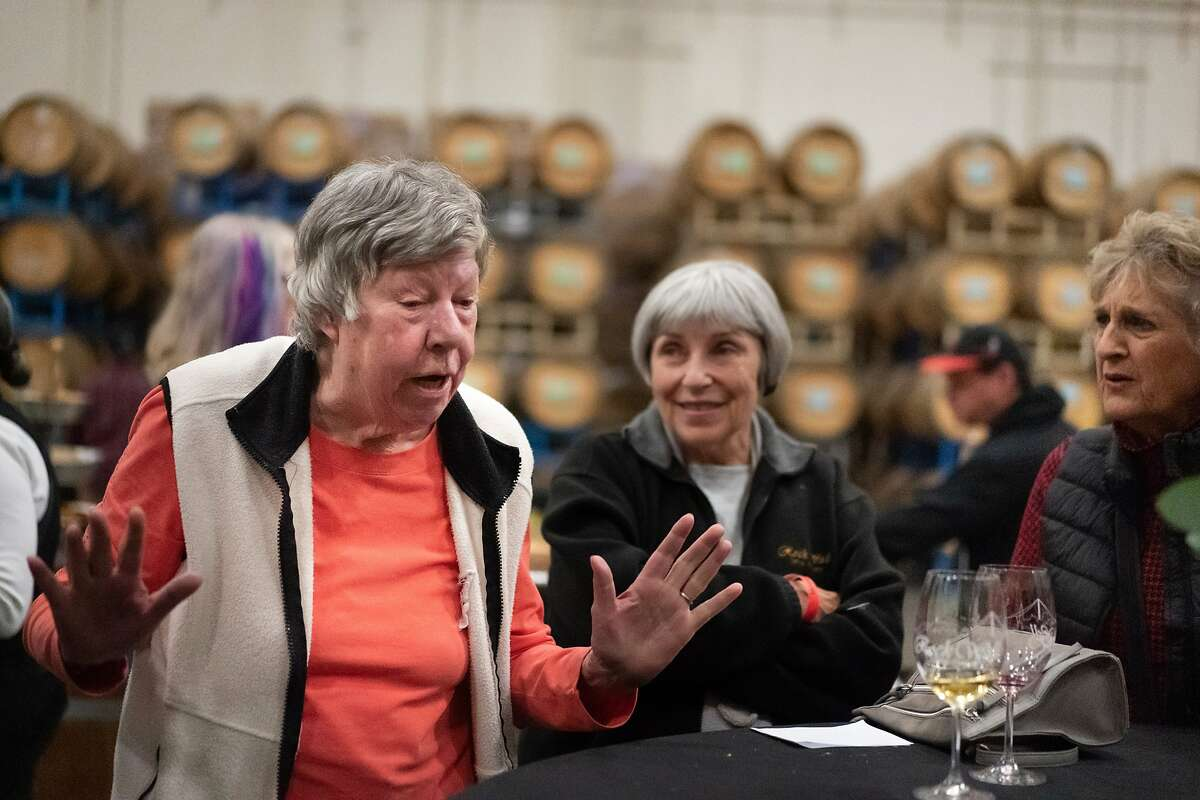 Kathy Rosenblum, a founder of Rock Wall Wine Co. chats with Donna Gibbs and Linda Flock during a members� event at Rock Wall Wine Co. on Saturday, Nov. 23, 2019, in Alameda, Calif.