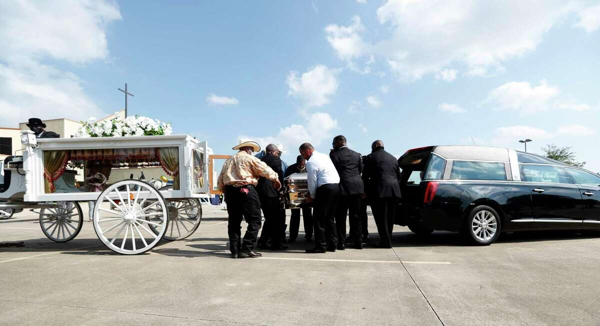 George Floyd's casket was transferred to a horse drawn carriage from a hearse a mile from the cemetery where he would be laid to rest on Tuesday, June 8, 2020.