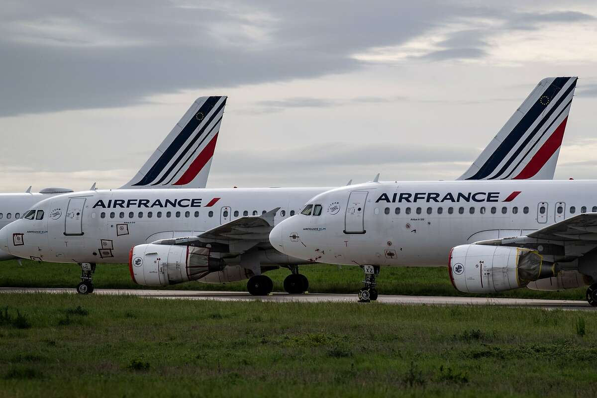 This file photo taken on April 30, 2020 shows Air France planes parked on the tarmac at Paris Charles de Gaulle Airport in Roissy, on the 45th day of the novel coronavirus COVID-19. Air travel means spending time in security lines and airport terminals, which puts you into close contact with other people. As travel slowly recovers, planes are becoming more crowded, which means you will likely sit close to other people, often for hours, which raises your risk. Once on a plane, most viruses and other germs don't spread easily because of the way air circulates, according to the U.S. Centers for Disease Control and Prevention. Airlines also say they are focusing on sanitizing the hard surfaces that passengers commonly touch.