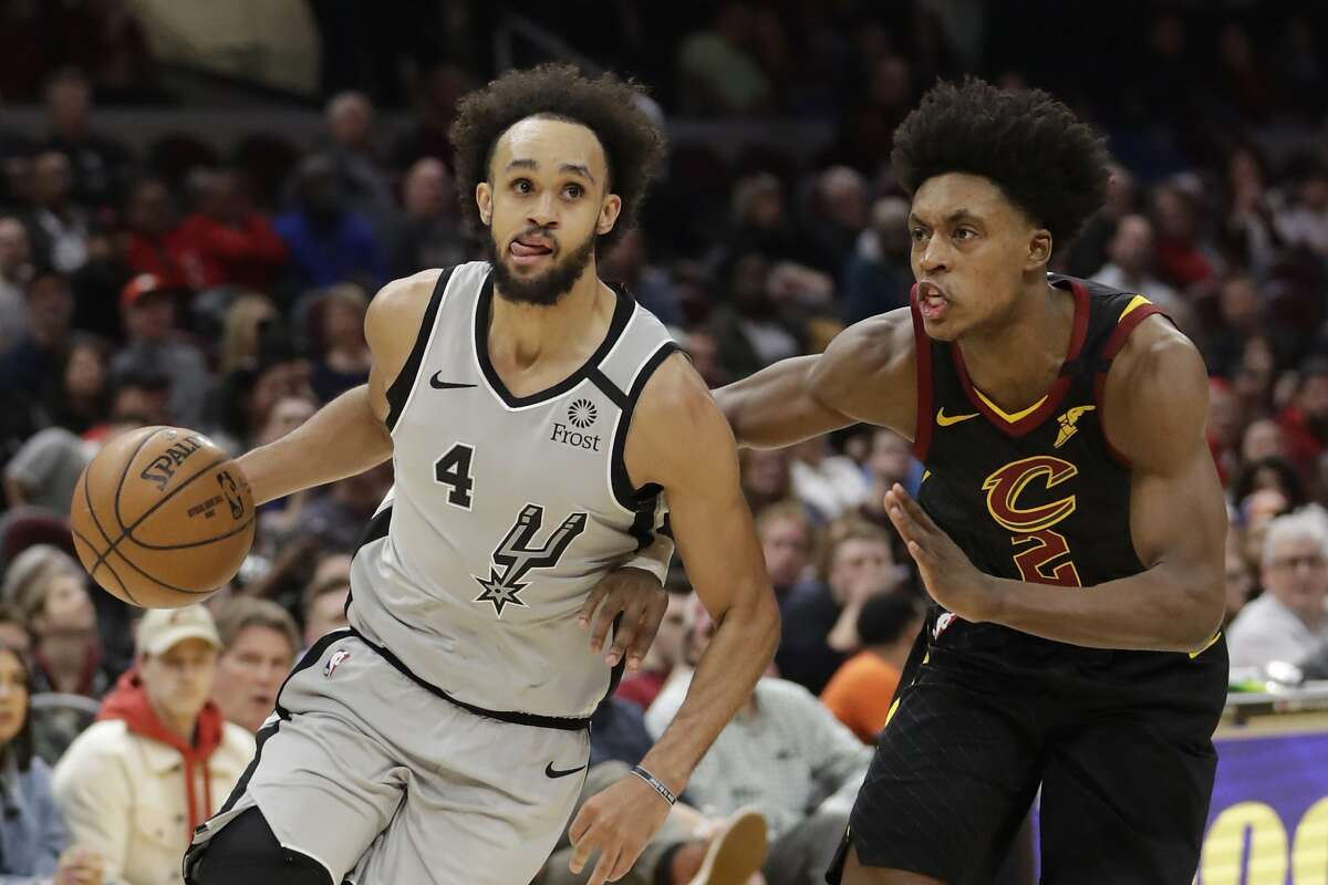 San Antonio Spurs' Derrick White (4) drives past Cleveland Cavaliers' Collin Sexton (2) in the second half of an NBA basketball game, Sunday, March 8, 2020, in Cleveland. (AP Photo/Tony Dejak)