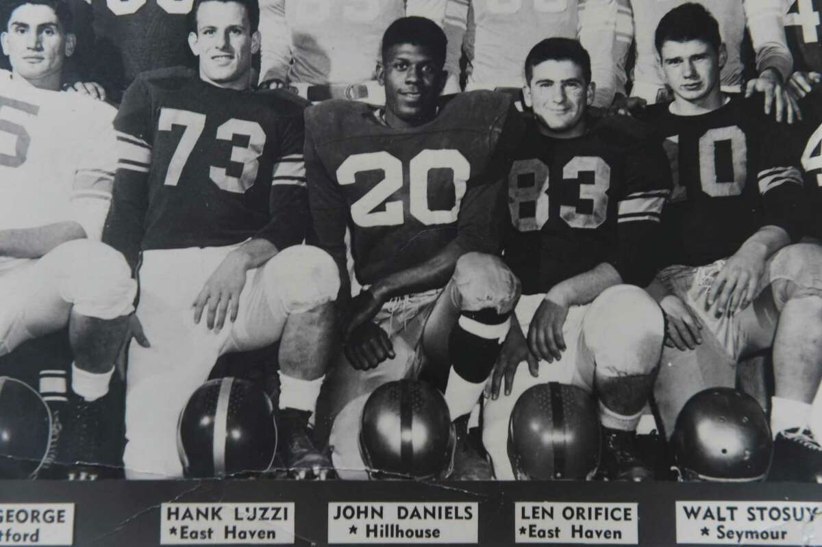 Future New Haven mayor, the late John Daniels Jr., 1954 New Haven Register All-State Football Team, #20 center, next to future East Haven mayor, the late Hank Luzzi of East Haven, #73.