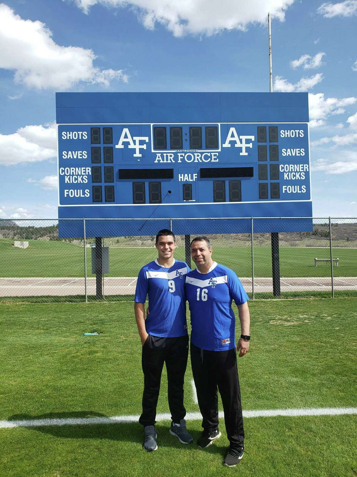 Jackson Macias poses with his father Gabe Macias at the Air Force Academy in Colorado Springs, Colorado.