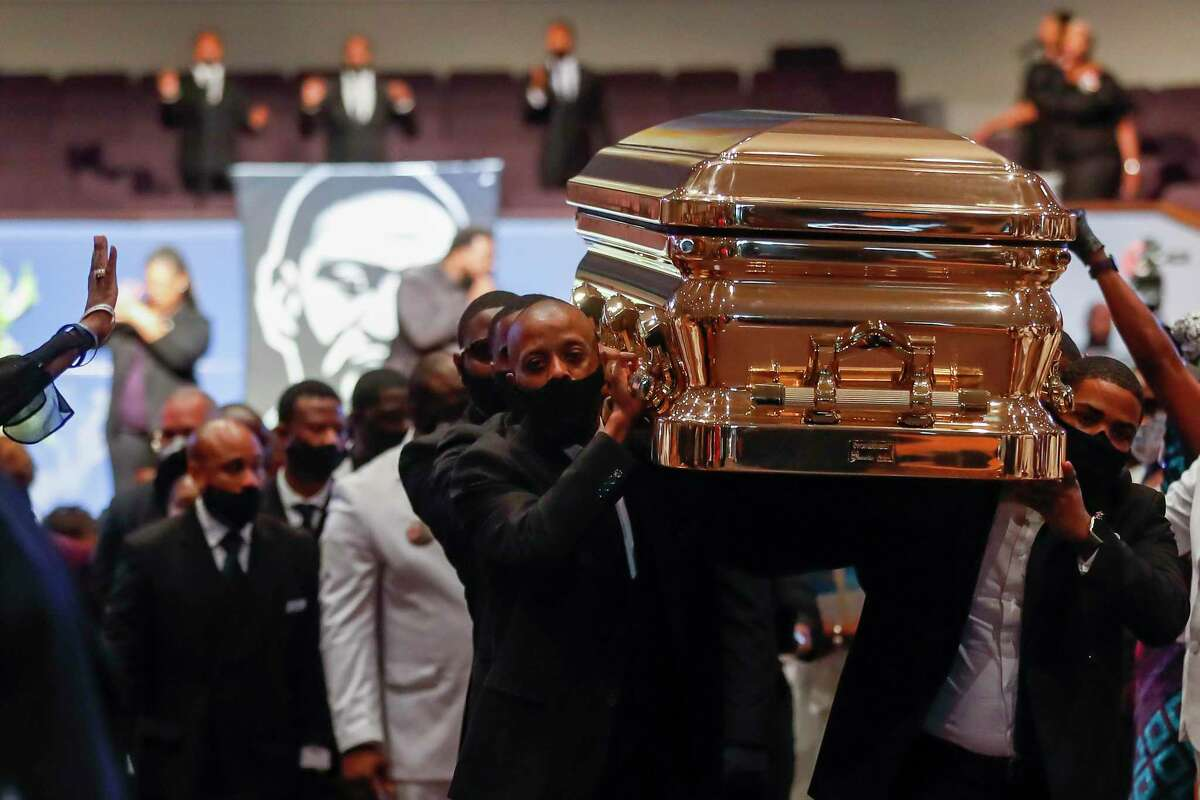 Pallbearers recess out of the church with the casket following the funeral for George Floyd on Tuesday, June 9, 2020, at The Fountain of Praise church in Houston. Floyd died after being restrained by Minneapolis Police officers on May 25.