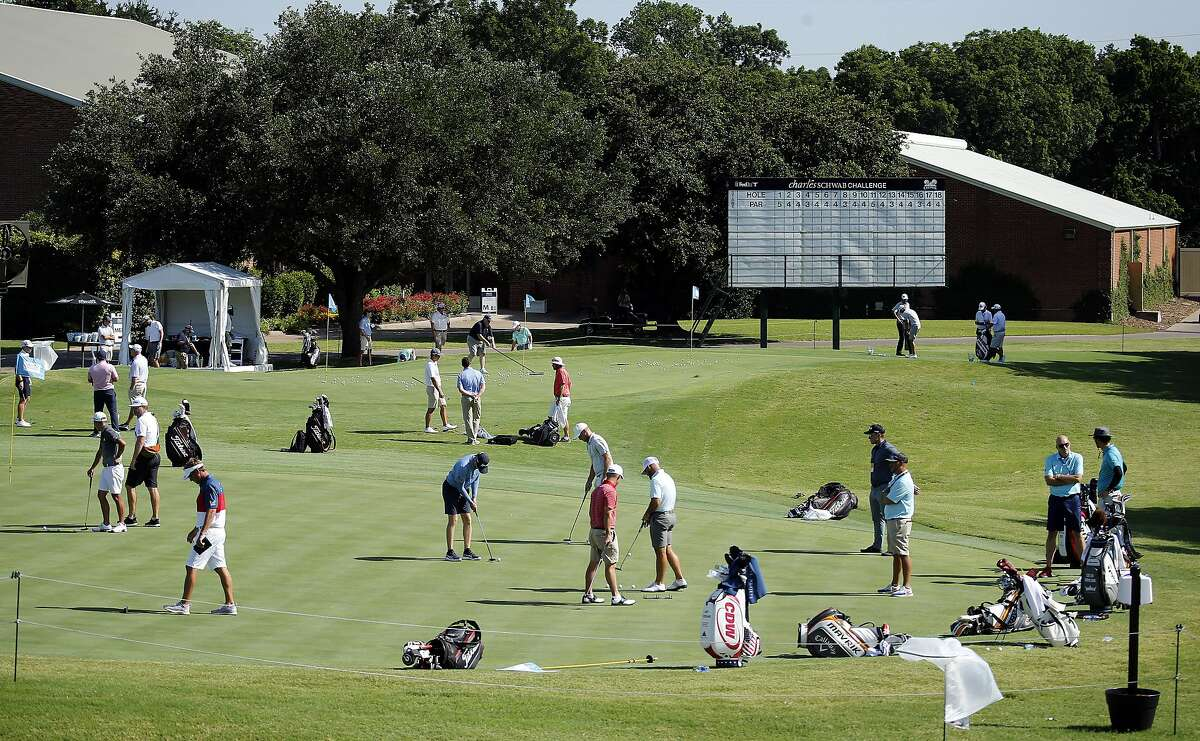 Golfers work on their putting and chipping around the practice greens during practice for the Charles Schwab Challenge golf tournament at the Colonial Country Club in Fort Worth, Texas, Tuesday, June 9, 2020. The Challenge is the first PGA tour event since the COVID-19 pandemic began. (Tom Fox/The Dallas Morning News via AP)