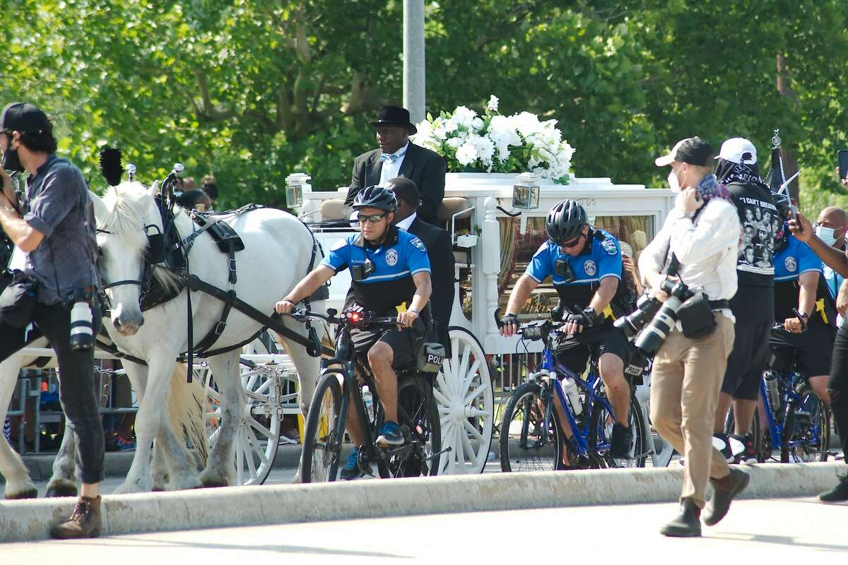 The remains of George Floyd are carried by horse drawn carriage to the final resting place in Pearland.