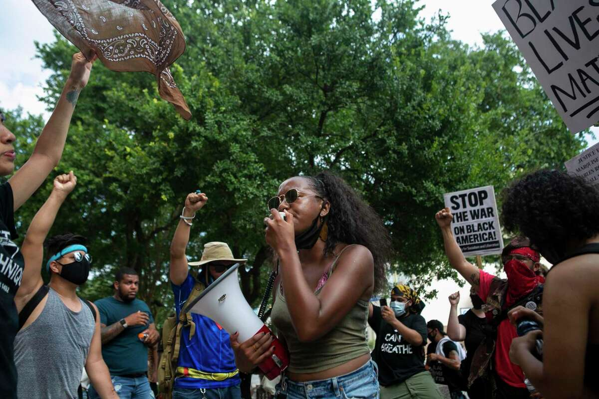 Kimiya Factory leads the crowd in a chant outside the Paul Elizondo Tower Building in downtown San Antonio, Texas, on June 9, 2020. Protesters rallied a day after Bexar County District Attorney Joe Gonzales said he did not plan to reopen the cases of Marquise Jones, Charles Roundtree and Antronie Scott, all of whom were killed by San Antonio police officers.