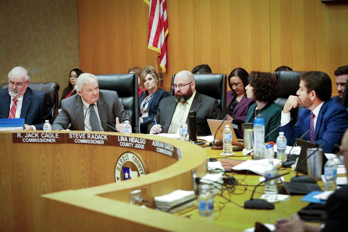 Harris County Commissioner Steve Radack (second from left) addresses a question to Commissioner Adrian Garcia (right) as Harris County constables express their feelings regarding a proposed study during the Harris County Commissioners Court Tuesday, March 10, 2020, in Houston.