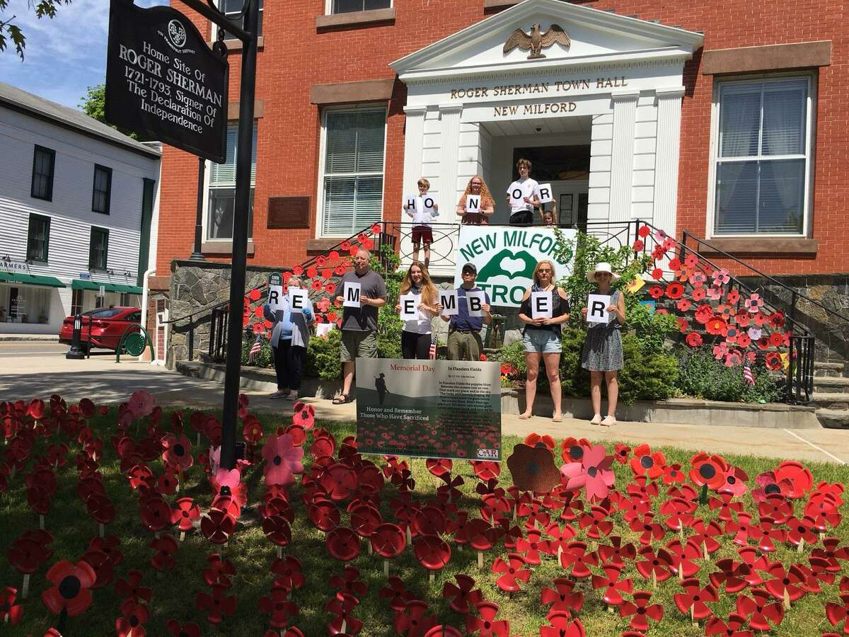 The Charlies Merriman Society, Connecticut Society Children of the American Revolution and the Roger Sherman Chapter, National Society Daughters of the American Revolution recently spearheaded a project to place homemade poppies outside Roger Sherman Town Hall in New Milford for Memorial Day. More than 350 poppies were created by children in the community and CAR members. Poppies were also placed around the war memorials on the Village Green. Above, members of CAR and DAR proudly stand in front of town hall after placing the poppies. They are, from left to right, in back, Jackson Delmore, Sydney Greenlaw, Ryan Delmore and Mary Rehnberg, and in front, Bonnie Butler, Scott Greenlaw, Alexis Delmore, Christopher Rehnberg, Metta Desmarais and Stephanie Rehnberg. Missing are Jon Delmore, Heidi Norcross and Jennie May Rehnberg, Senior State President.